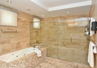 Master Suite Bathroom with jacuzzi & spa seat inside the shower